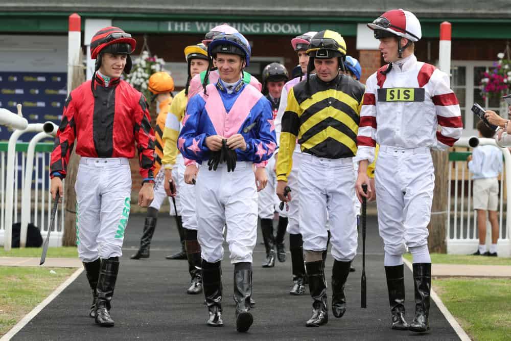 Jockeys walking together